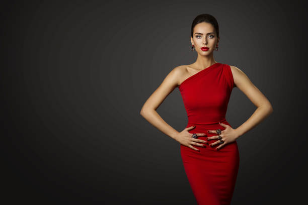 Fashion Model Red Dress, Elegant Woman in Sexy Evening Gown, Beautiful Girl on Black Background stock photo