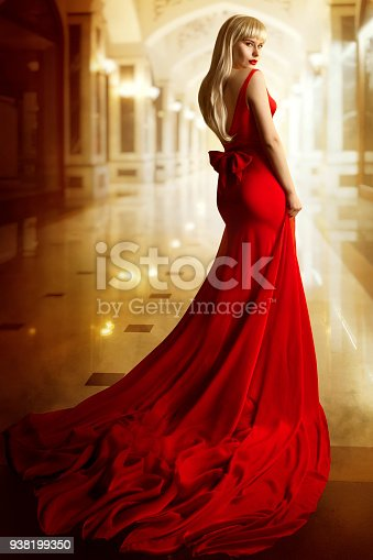 Fashion Model Red Dress, Woman Beauty Portrait, Sexy Girl with Blond Hair in Long Gown, Elegant Lady Turning over Shoulder and looking at camera
