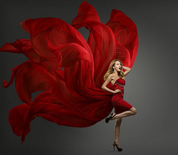 fashion model red dress, woman dancing flying fabric waving cloth - lange abendkleider stock-fotos und bilder