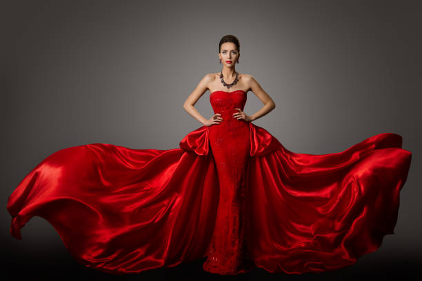 Fashion Model Red Dress, Woman in Long Fluttering Waving Gown, Young Girl Beauty Portrait stock photo