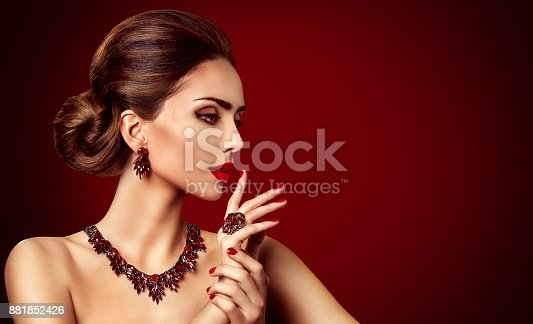 Fashion Model Red Stone Jewelry, Woman Retro Makeup and Red Gemstones Ring Earrings Necklace, Beautiful Girl looking side over red background
