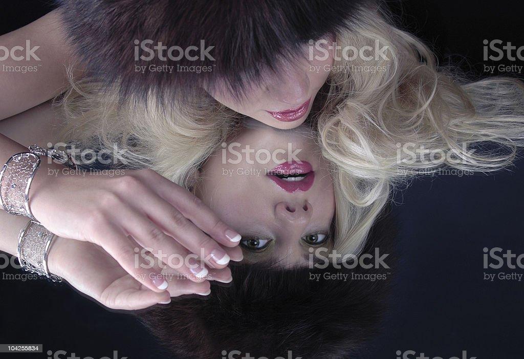 Fashion model reflecting in mirrow royalty-free stock photo