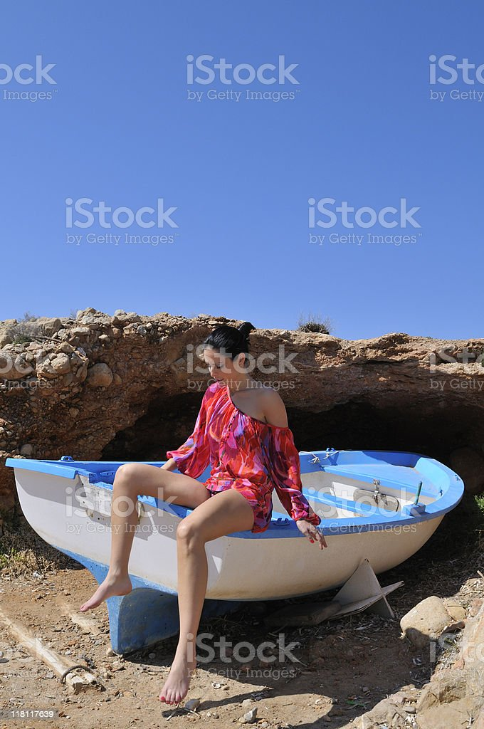 Fashion model seated in a boat royalty-free stock photo
