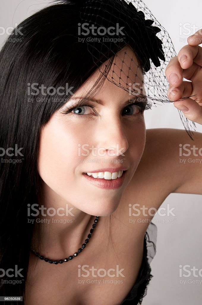 Fashion model smiles and peaks from under veil. royalty-free stock photo