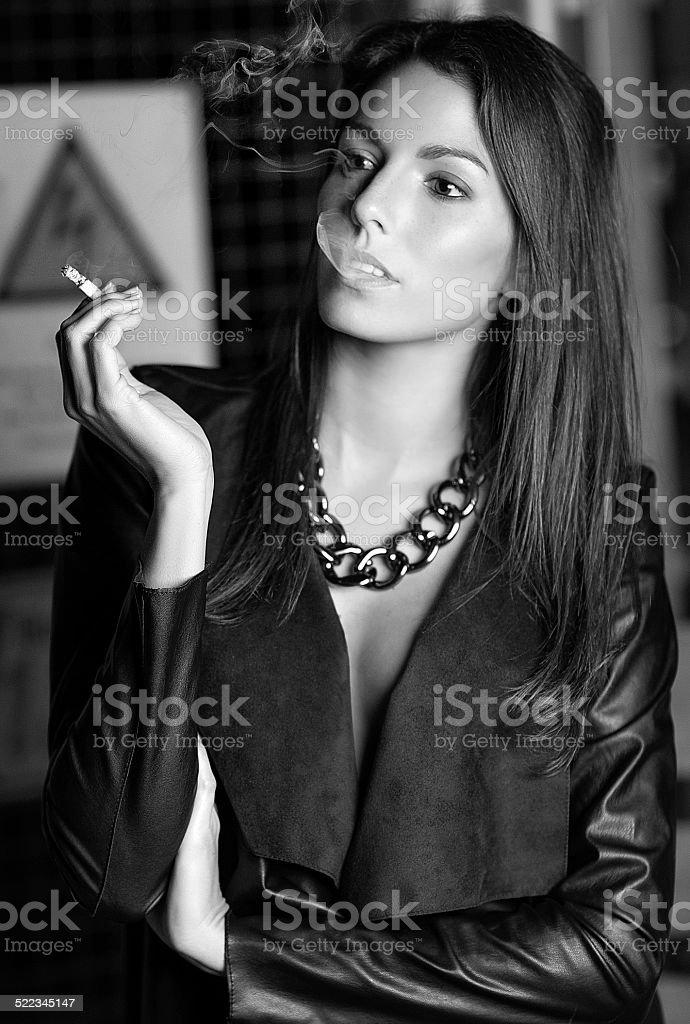 Fashion Model smoking in a Warehouse stock photo