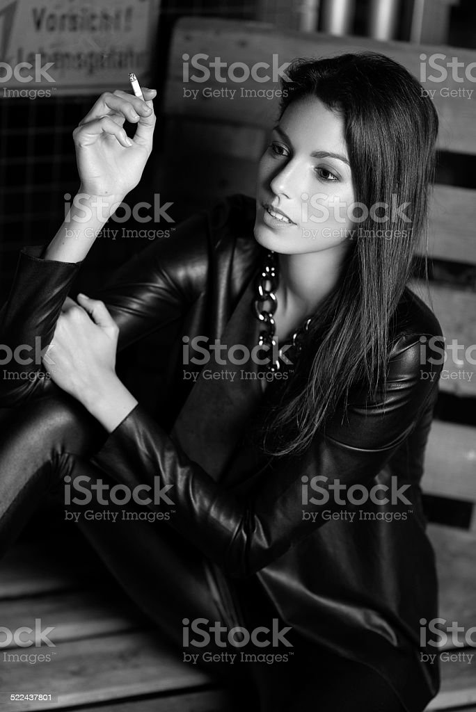 Fashion Model smoking in a Warehouse stock photo