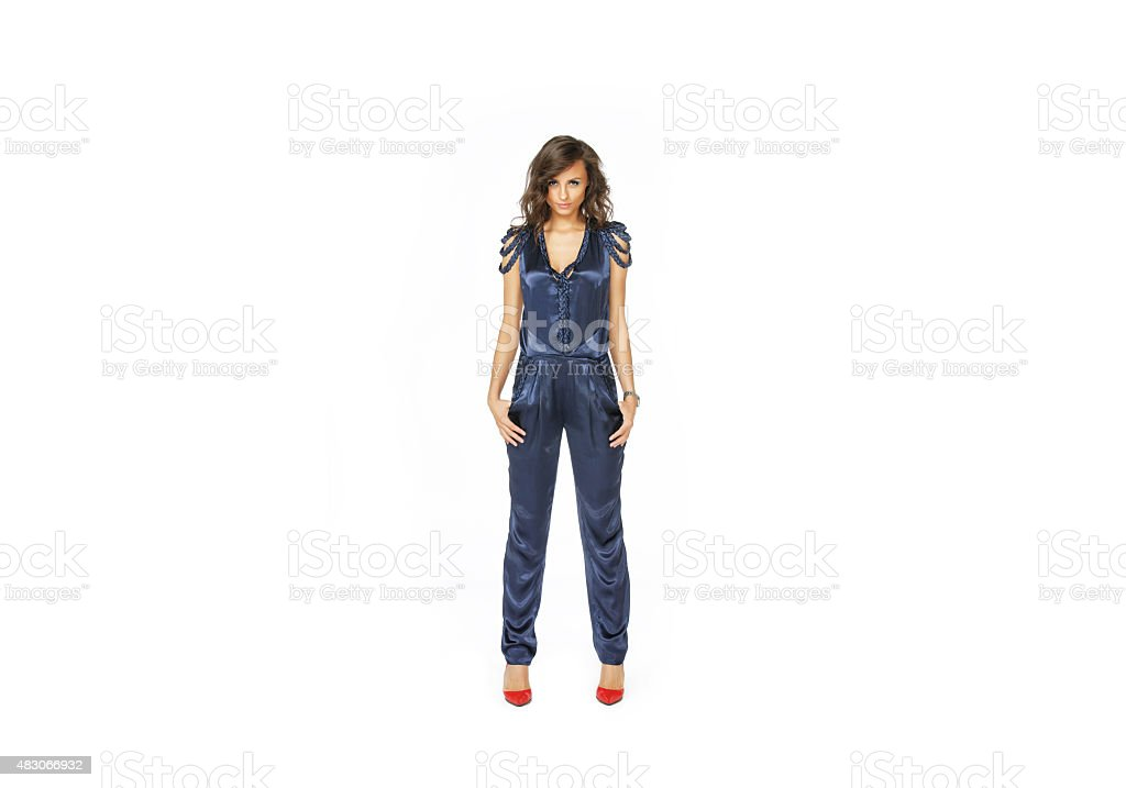 Fashion model standing in blue overall stock photo