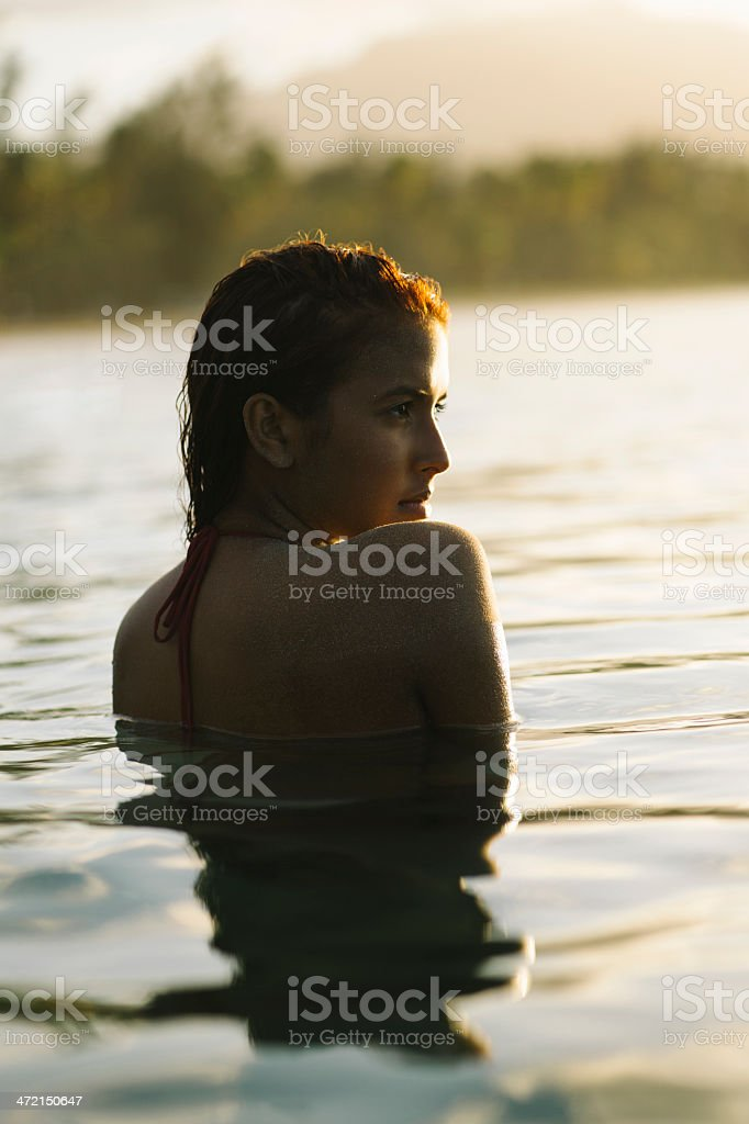 Fashion model taking a swim royalty-free stock photo