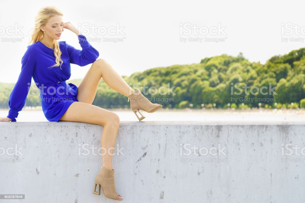 Fashion model wearing blue jumpsuit stock photo