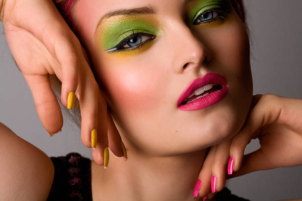 Fashion Model Wearing Neon Make-up  pink nail polish stock pictures, royalty-free photos & images