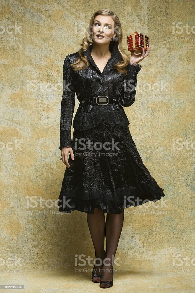 Fashion Model With A Christmas Present royalty-free stock photo