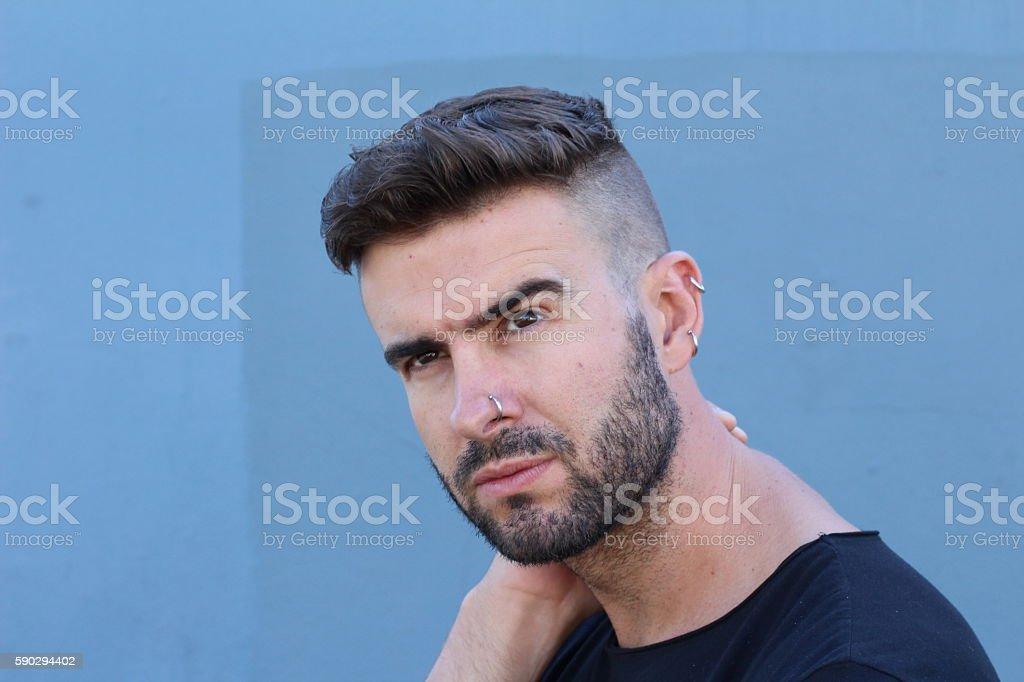 Fashion model with beard and piercing posing royaltyfri bildbanksbilder