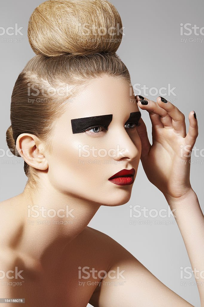 Fashion model with creative make-up, bun hairstyle stock photo