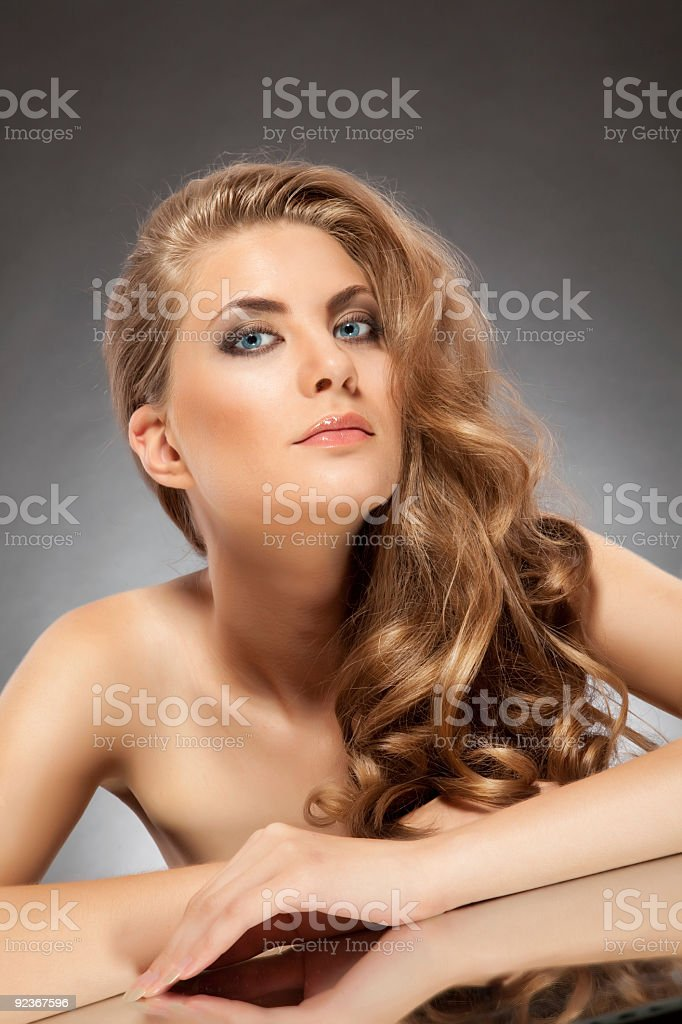 Fashion model with long brunette hair. royalty-free stock photo
