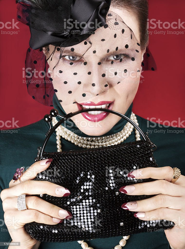 Fashion model with nail art,bag, pearls and hat. royalty-free stock photo