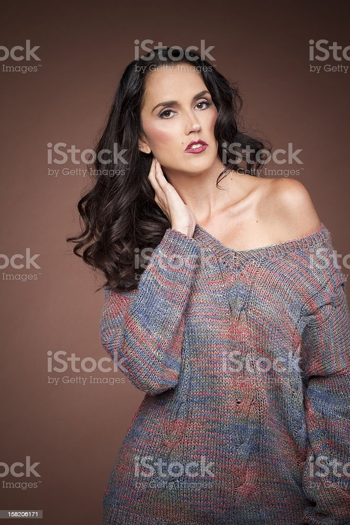 Fashion model with one shoulder exposed stock photo