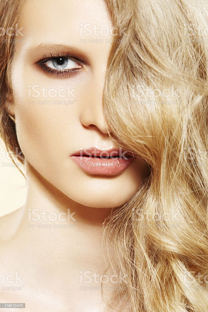 Fashion model with perfect long hair and evening make-up royalty-free stock photo
