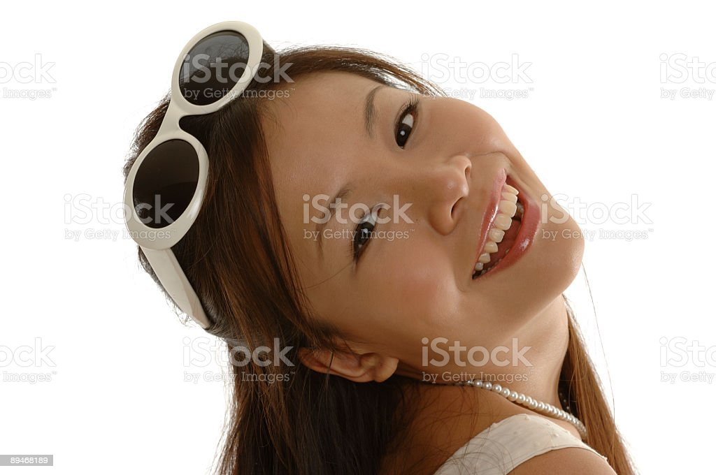 Fashion model with smile and sunglasses - close-up royalty-free stock photo