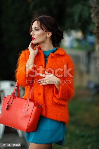 518885222istockphoto Fashion model woman in a modern image of a stylish girl 1210265464