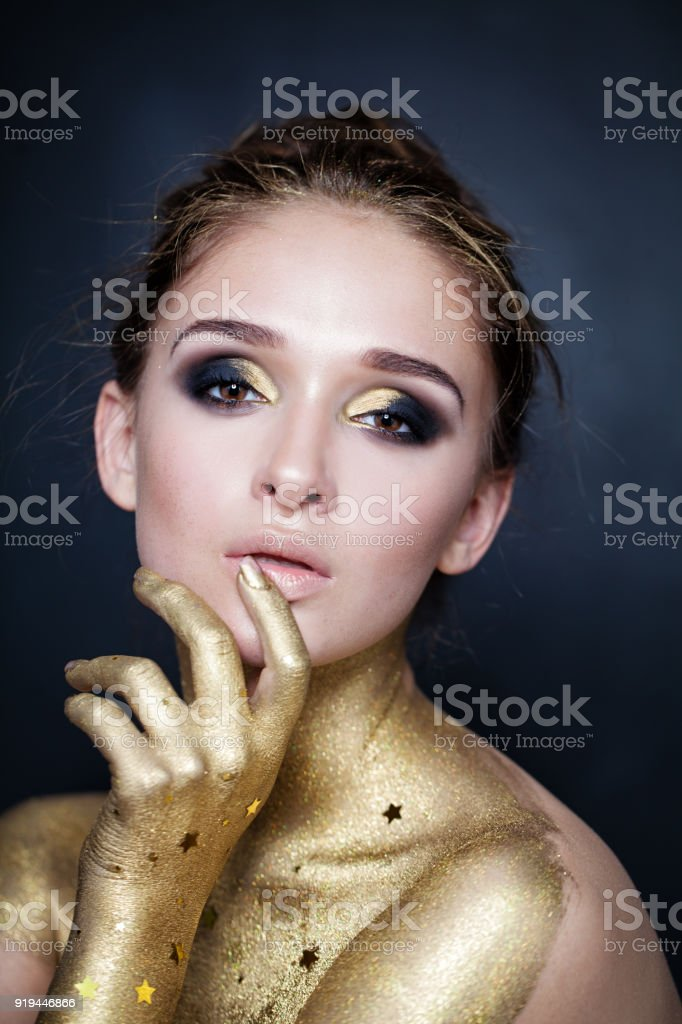 fashion model woman with halloween makeup on blue background royalty free stock photo
