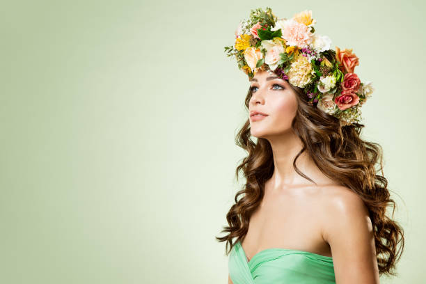 Fashion Models Flowers Wreath Beauty Portrait, Woman Makeup Hairstyle with Roses, Beautiful Girl Flower in Hair stock photo