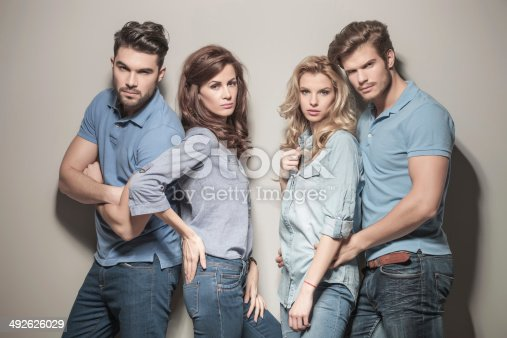 621502402 istock photo fashion models in blue jeans and casual polo shirts 492626029