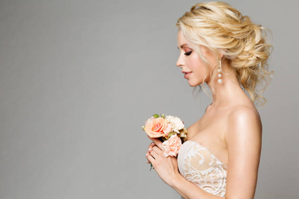 fashion models profile portrait with flowers bouquet, beautiful woman bride makeup and hairstyle, girl studio shot - wedding fashion stock pictures, royalty-free photos & images