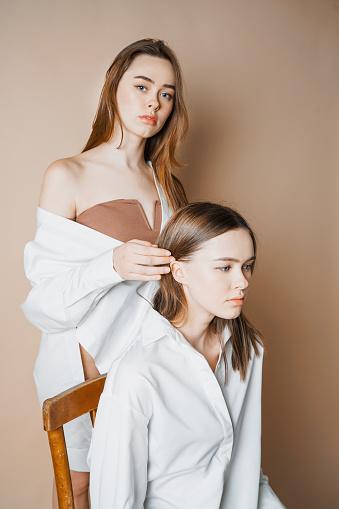 Fashion models two sisters twins beautiful nude girls