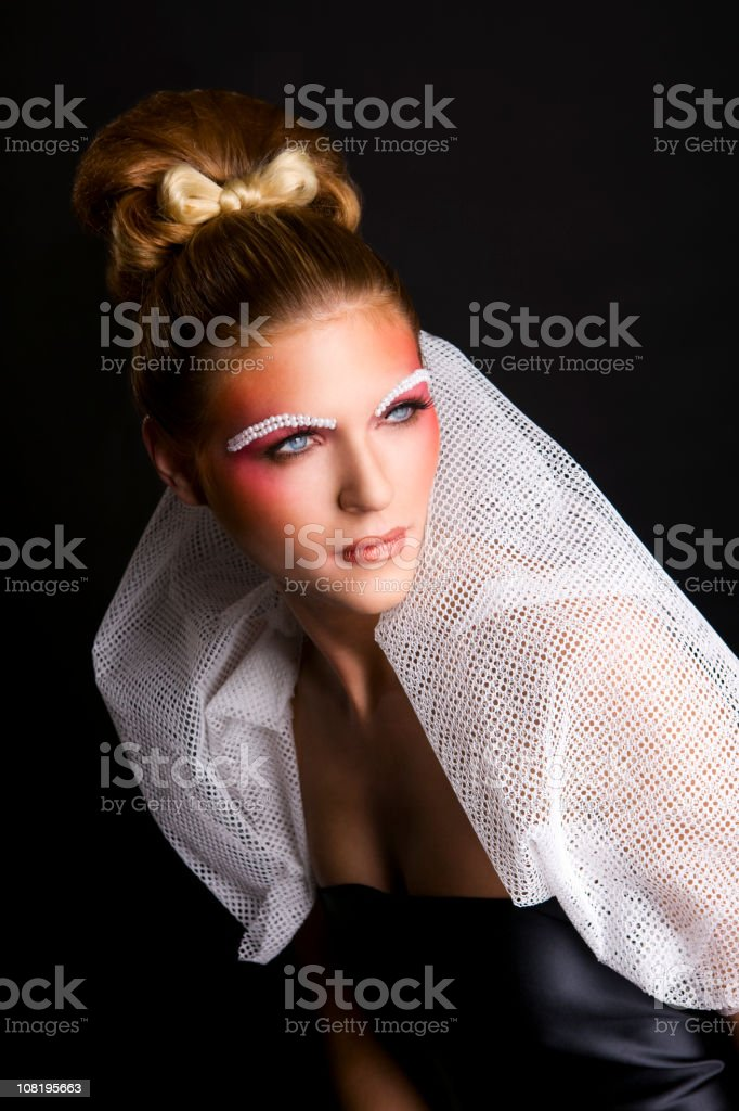 Beautiful Blond Fashion Model in Evening Gown with Pearl Eyebrows royalty-free stock photo
