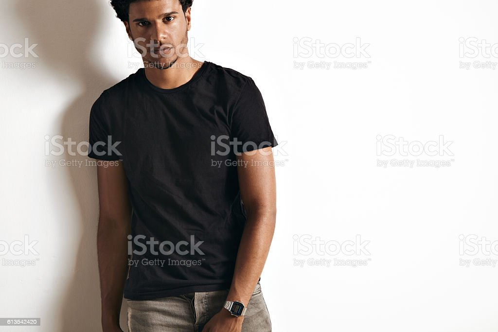 Fashion photo of a handsome man in black t-shirt stock photo