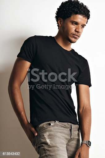 istock Fashion photo of a handsome man in black t-shirt 613543432