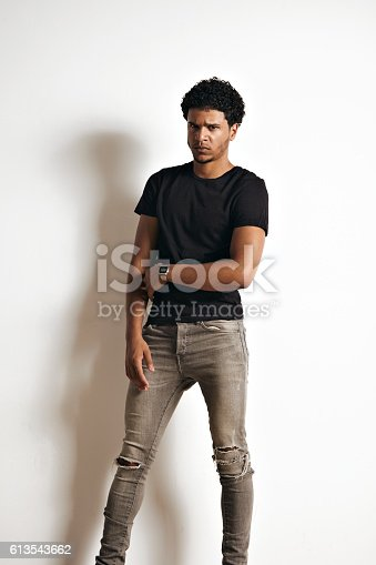 613542420 istock photo Fashion photo of a handsome man in black t-shirt 613543662