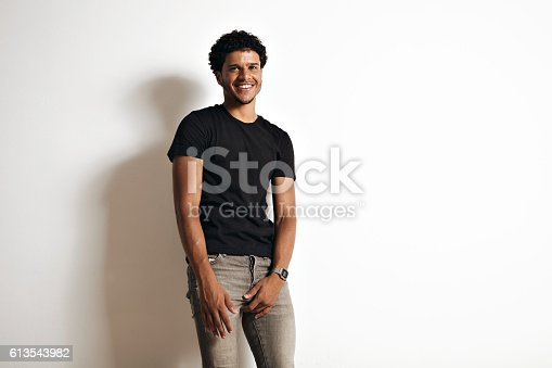 istock Fashion photo of a handsome man in black t-shirt 613543982
