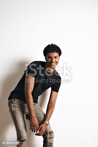 istock Fashion photo of a handsome man in black t-shirt 613544108