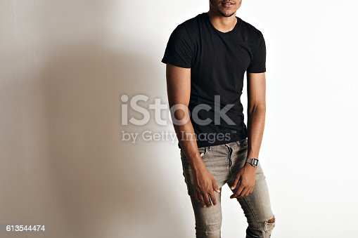 613542420 istock photo Fashion photo of a handsome man in black t-shirt 613544474