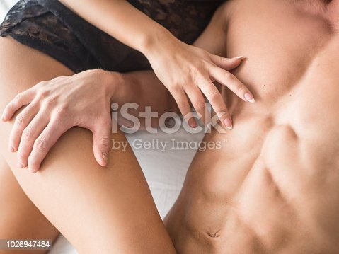 Fashion photo of beautiful sexy couple relaxing and embracing in the bedroom.
