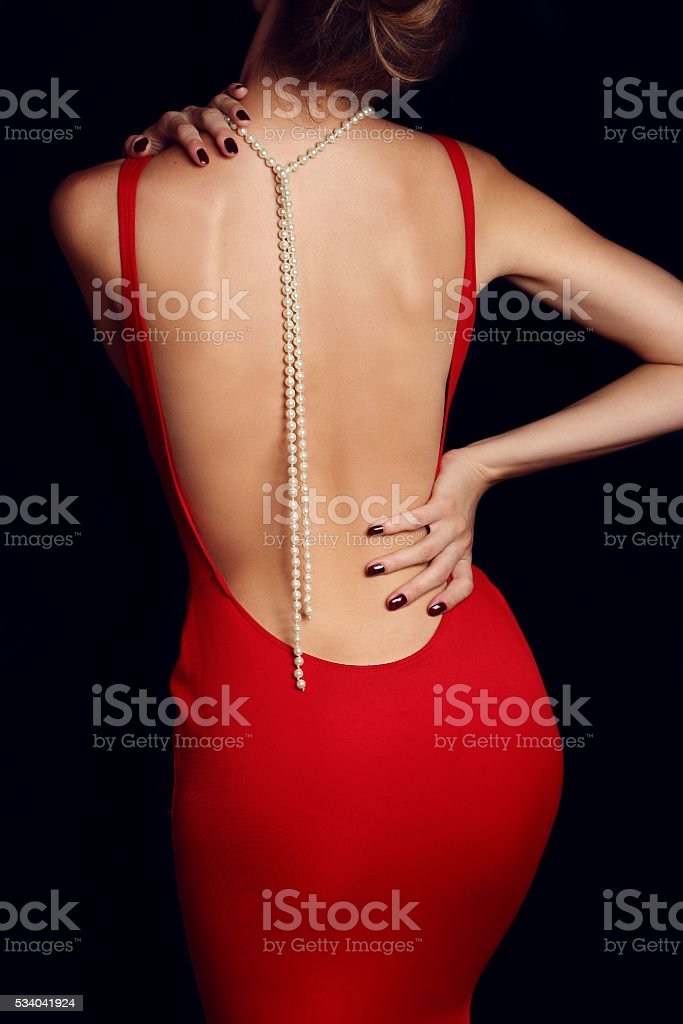 fashion photo of beautiful woman in a red evening dress stock photo
