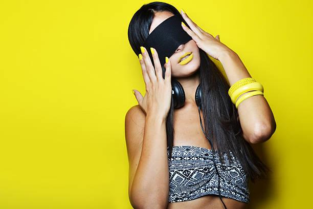 fashion photo of beautiful woman - blindfolded headphones bildbanksfoton och bilder