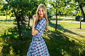 Outdoor fashion photo of young magnificent woman wearing fashionable summer clothes