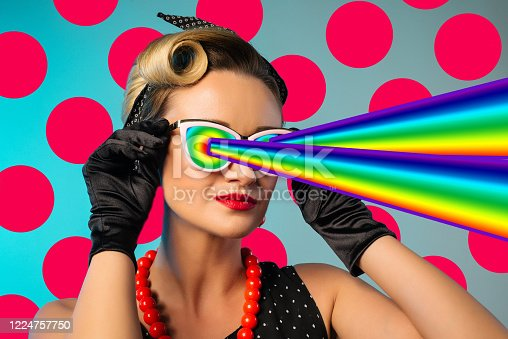 1125575680 istock photo Fashion pin up woman with rainbow lasers from eyes. Minimal collage art 1224757750