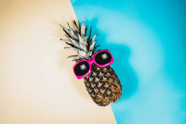 fashion pineapple. summer color. - aura stock photos and pictures