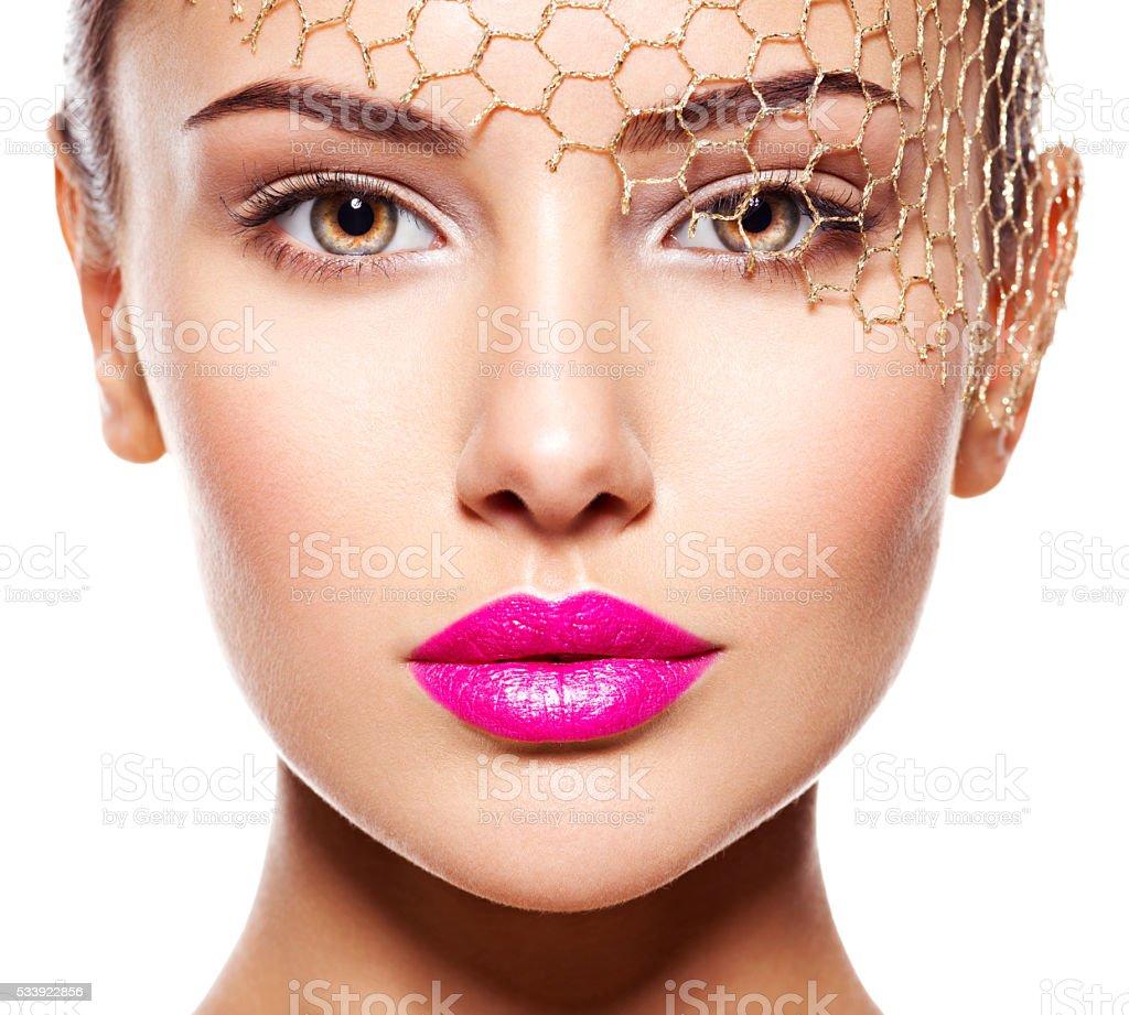 Fashion portrait of a beautiful  girl wears golden veil on stock photo
