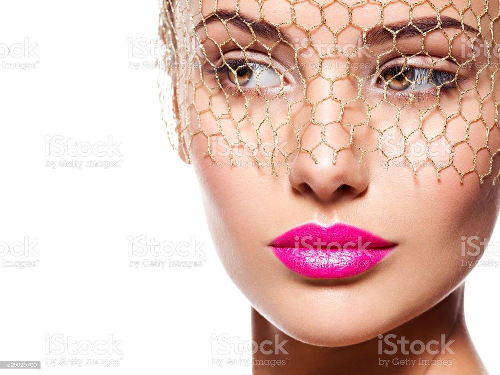 Fashion portrait of a beautiful  girl wears veil on eyes stock photo