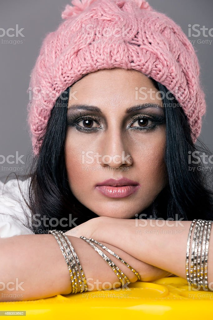 fashion portrait of a beautiful indian girl in winter cap royalty-free stock photo