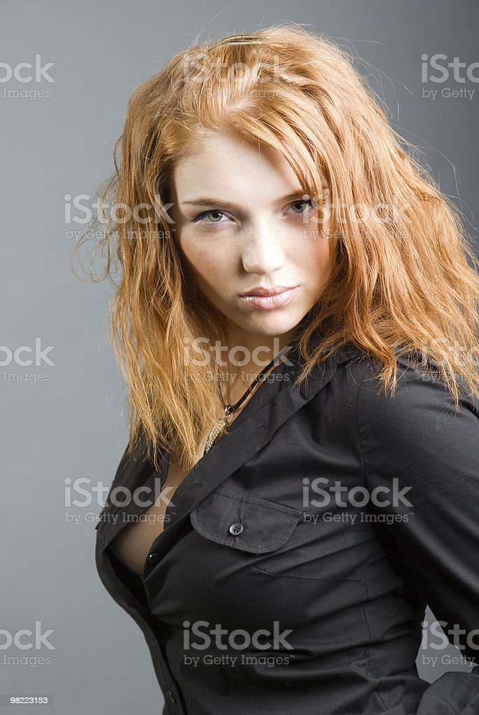 fashion portrait of a red hair sexy woman, royalty-free stock photo