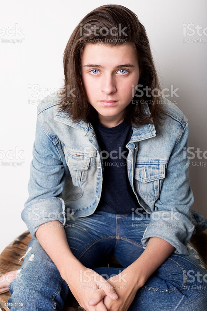 Fashion portrait of a teenager wearing jeans jacket stock photo