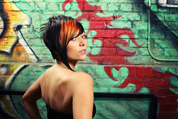 Fashion Portrait of a Young Woman on Colorful Background stock photo