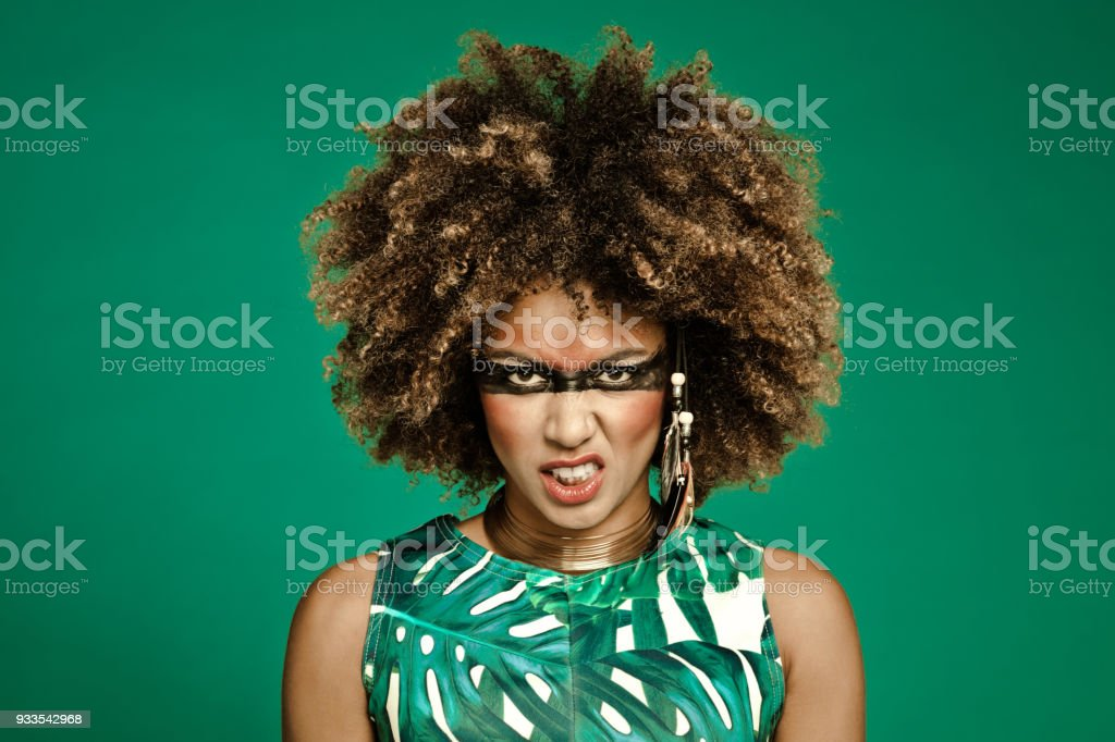 Fashion portrait of angry female warrior stock photo