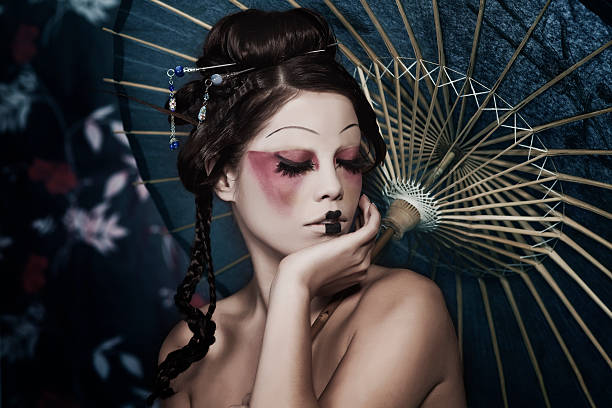 fashion portrait of beautiful white girl in geisha attire - geisha girl stock photos and pictures