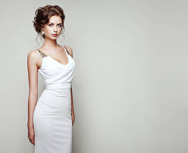 Fashion portrait of beautiful woman in elegant dress stock photo